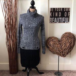 Iz Byer marled turtleneck dress with black skirt.